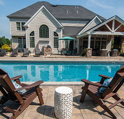 In-ground pool with pavers